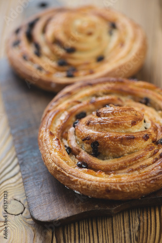 Foto op Plexiglas Bakkerij Close-up of french sweet buns, vertical shot