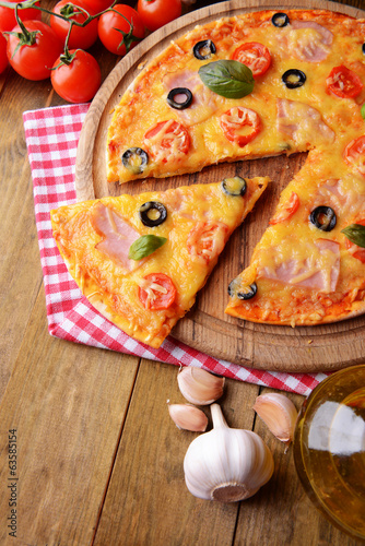 Tasty pizza on table close-up © Africa Studio