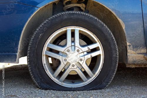 Fotografie, Obraz  Flat Car Tire on Gravel Road