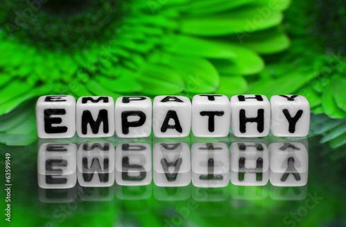 Fotografia  Empathy text with green flowers
