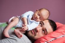 Newborn Baby Sleeping With Father