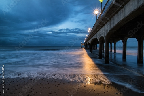 Spoed Foto op Canvas Grijze traf. Twilight dusk landscape of pier stretching out into sea with moo
