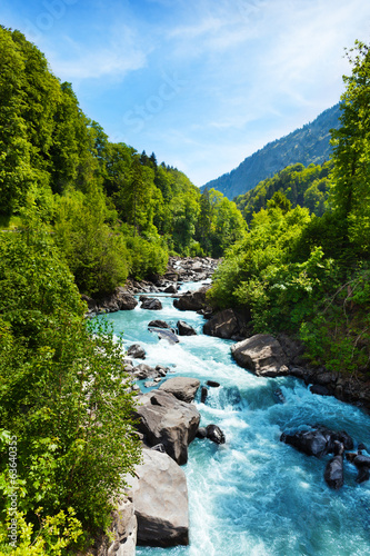 Foto op Canvas Blauwe hemel Vivid Swiss landscape with pure river stream