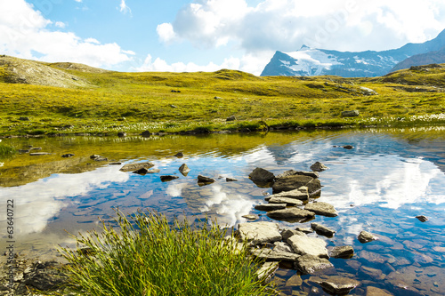 Printed kitchen splashbacks Reflection Sentiero in acqua su sassi, Gran Paradiso, Valle d'Aosta