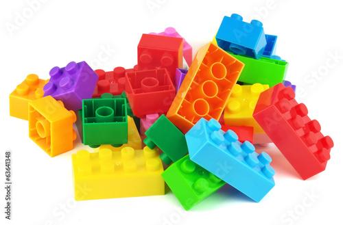 Fotografija  Toy colorful plastic blocks isolated on white