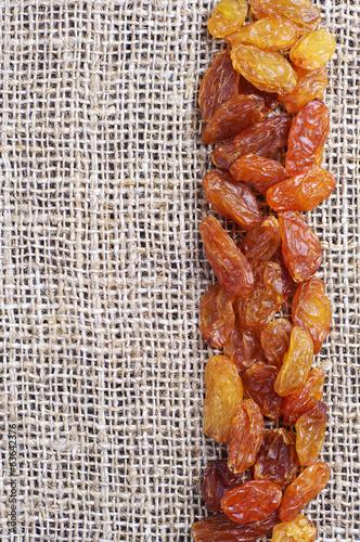 Naklejka - mata magnetyczna na lodówkę Background with raisins