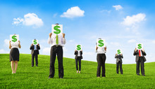 Business People Holding Placards With Dollar Signs Outdoors