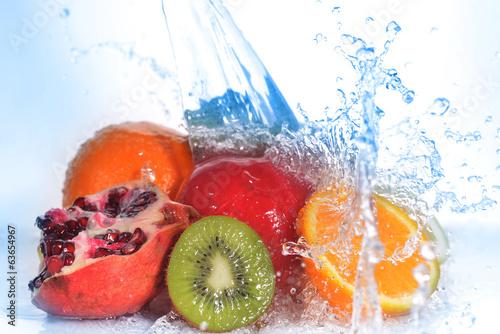 Fototapeta slices of kiwi,  orange, pomegranate and  lemon obraz na płótnie