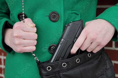 Fotografie, Obraz  Woman with Concealed Weapon