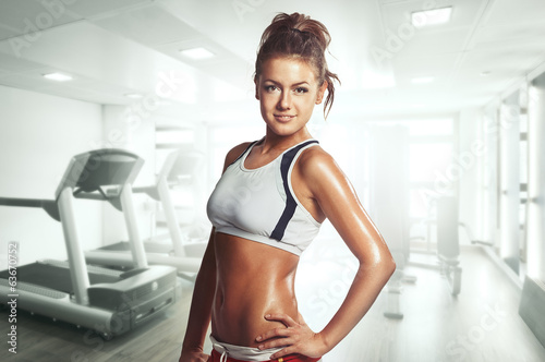 Fotografija  Sexy female athlete in the gym