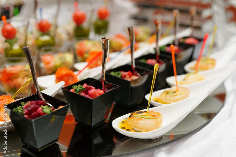 Fototapety, obrazy: Various snacks on table