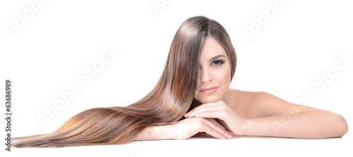 Fotografiet Beautiful young woman with long hair isolated on white