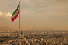Iran Flag In The Wind Above Sk...