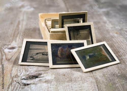 Old slides on a wooden background