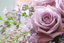 Bouquet Of Roses And Lilacs