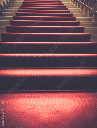 Fotografie, Obraz  Stairs covered with red carpet