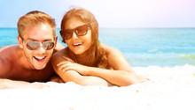 Happy Couple In Sunglasses Hav...