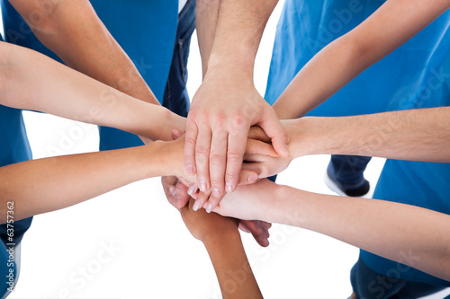 Fototapety, obrazy: Group of cleaners stacking hands