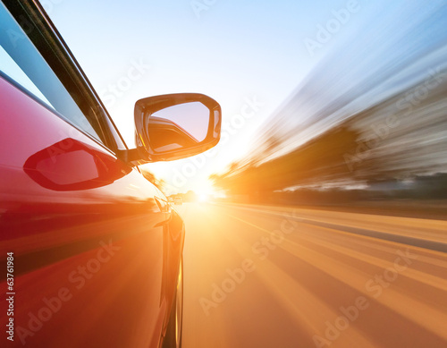 car on the road with motion blur background. Wallpaper Mural