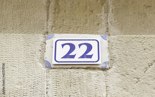 Fotografia  Number twenty-two on a wall