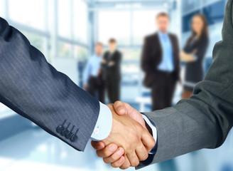 Naklejka Business associates shaking hands in office