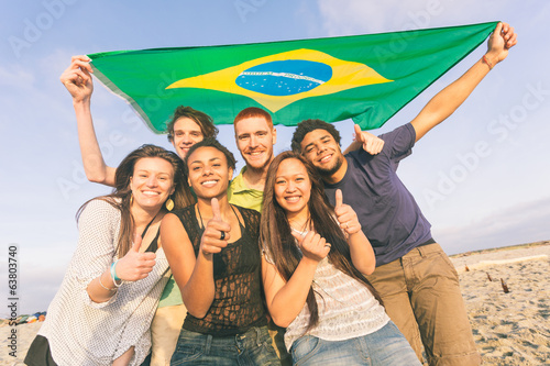 Photo  Group of Friends with Brazilian Flag at Beach