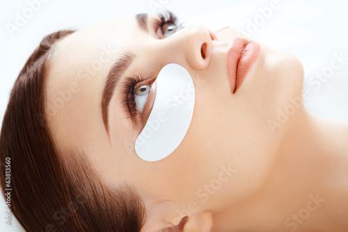 Fotografie, Obraz  Kosmetické ošetření. Žena oko s dlouhými řasami. Řasy prodlouž