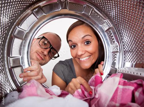Fotografie, Obraz  Young couple doing laundry