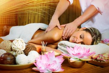 Panel SzklanyBeautiful woman having massage.