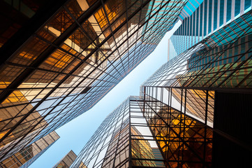 FototapetaUpwards perspective of glass commercial skyscrapers, Hong Kong
