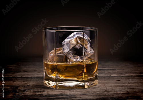 Tuinposter Bar Glasses of whiskey on wood background.