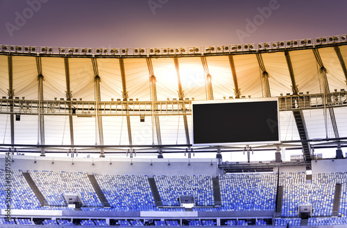 Poster de jardin Stade de football Empty stadium with electronic billboard