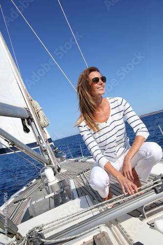 Tuinposter Zeilen Attractive modern woman enjoying sailing cruise