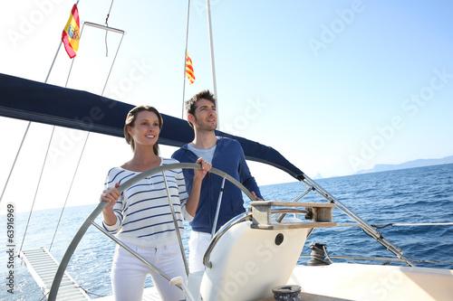 Cadres-photo bureau Voile Couple sailing on the mediterranean sea