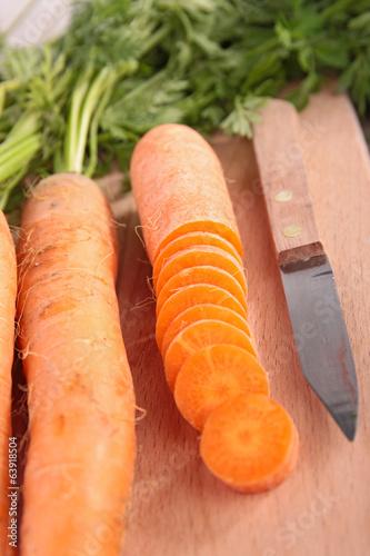 raw carrot on board