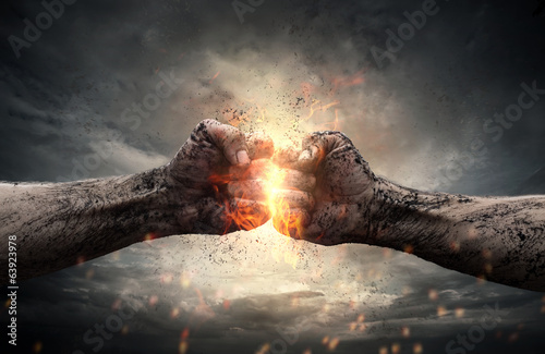 Canvas Print Fight, two fists hitting each other over dramatic sky