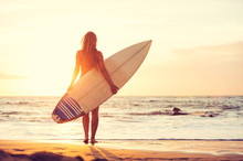 Surfer Girl On The Beach At Su...