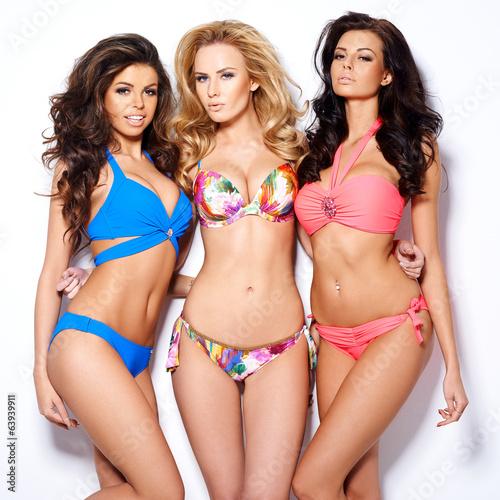Trio of stunning young women in bikinis