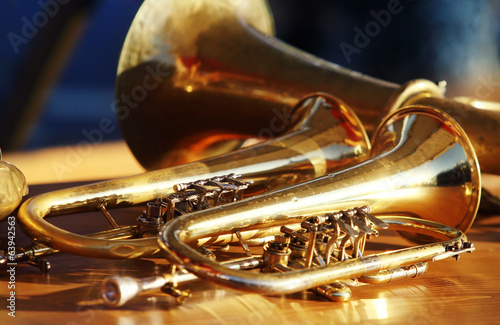 blowing-brass-wind-instrument-on-table