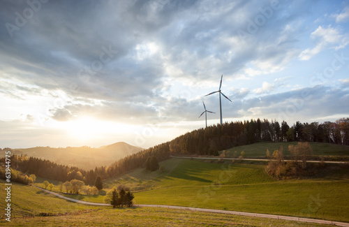Poster Bleke violet wind power mills in black forest landscape, Germany