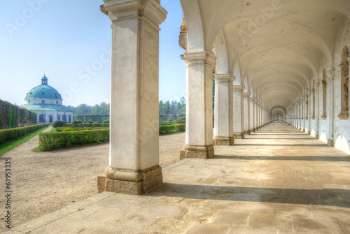 Long colonnade and baroque pavilion in city gardens Canvas Print