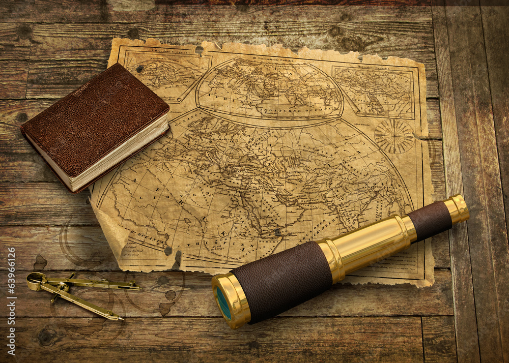 Photo  Old world map with telescope