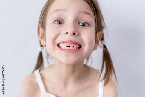 Close up portrait of preschooler girl with wide smile Poster
