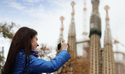 Female tourist   photographing  Sagrada Familia at Barcelona Wallpaper Mural