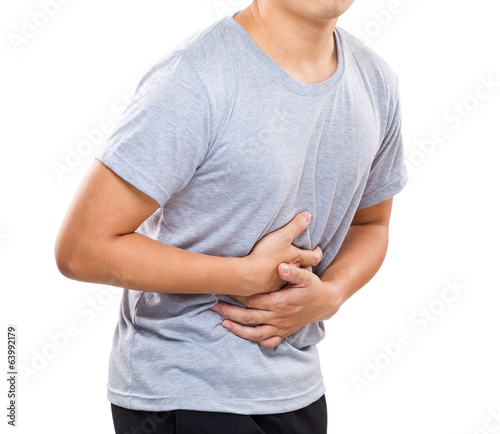 Foto  Man suffering from stomach pain