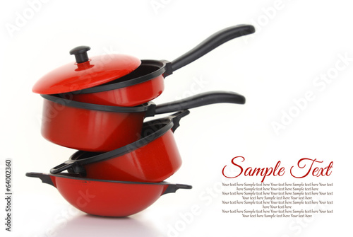Cuadros en Lienzo  Red cookware set on white background