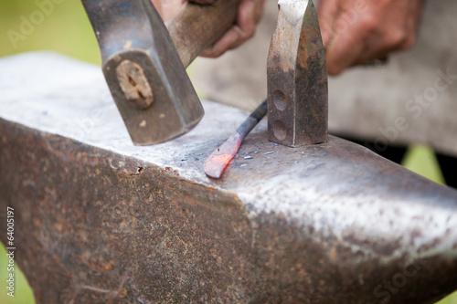 Vászonkép forger une lame de couteau