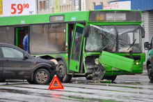 Car Accident And A Passenger Bus