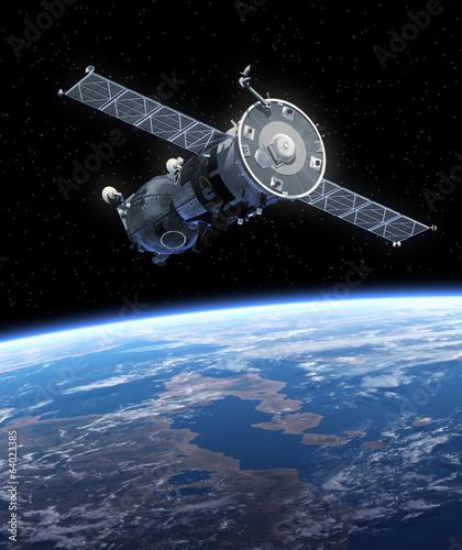 """fototapeta na lodówkę Statek kosmiczny """"Sojuz"""" krążących wokół Ziemi."""