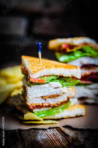 Deurstickers Klaar gerecht Club sandwich on rustic wooden background